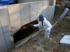 Application of J-Cote Waterproofing to a foundation