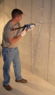 Technician Injecting a Basement Wall Crack