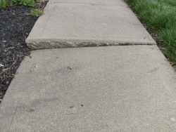 Concrete sidewalk before lifting